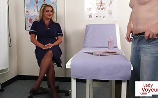 Bigtitted nurse spycam encouraging victim to tug